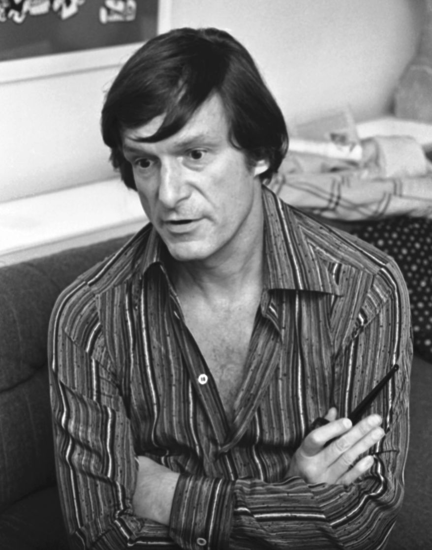 Playboy publisher Hugh Hefner interviewed in Playboy Corps hotel suite at the Drake Hotel, Oct. 11, 1977, New York. (AP Photo/Carlos Rene Perez)