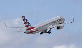 FILE - In this Friday, June 3, 2016, file photo, an American Airlines passenger jet takes off from Miami International Airport in Miami. A scheduling glitch involving airline pilot time-off requests has imperiled thousands of flights from Dec. 17-31, Reuters reported on Nov. 29, 2017. (AP Photo/Alan Diaz, File)
