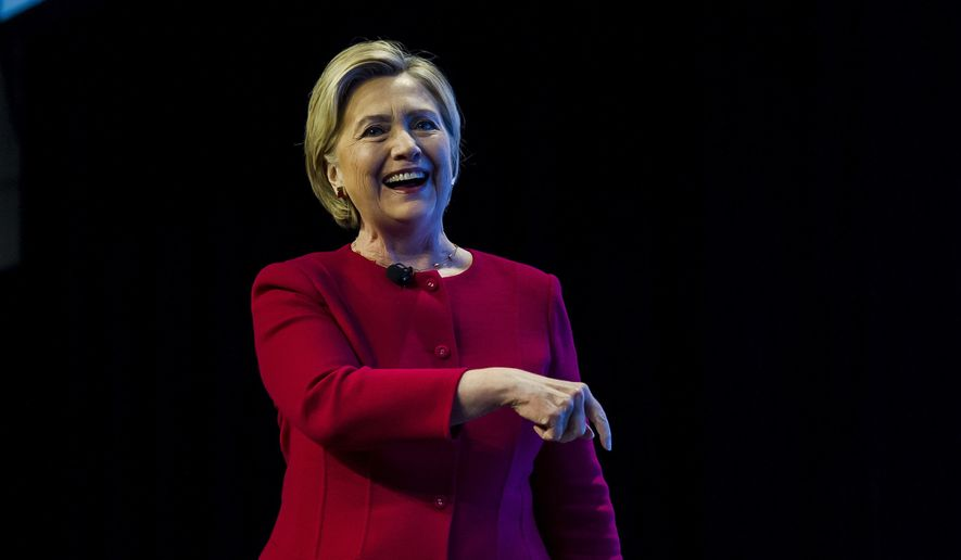 "Former U.S. presidential candidate Hillary Clinton speaks to an audience in Toronto promoting her new book ""What Happened,"" Thursday, Sept. 28, 2017. (Christopher Katsarov/The Canadian Press via AP) ** FILE **"