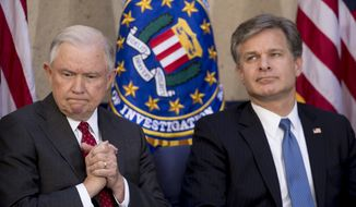Attorney General Jeff Sessions sits with FBI Director Chris Wray at an installation ceremony for Wray at the FBI Building, Thursday, Sept. 28, 2017, in Washington. (AP Photo/Andrew Harnik)