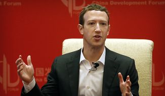 In this Saturday, March 19, 2016, file photo, Facebook CEO Mark Zuckerberg speaks during a panel discussion in Beijing. (AP Photo/Mark Schiefelbein, File)