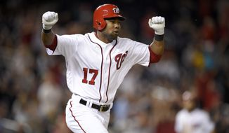 Washington Nationals' Alejandro De Aza reacts after he singled in the winning run during the ninth inning of a baseball game against the Pittsburgh Pirates, Thursday, Sept. 28, 2017, in Washington. (AP Photo/Nick Wass)