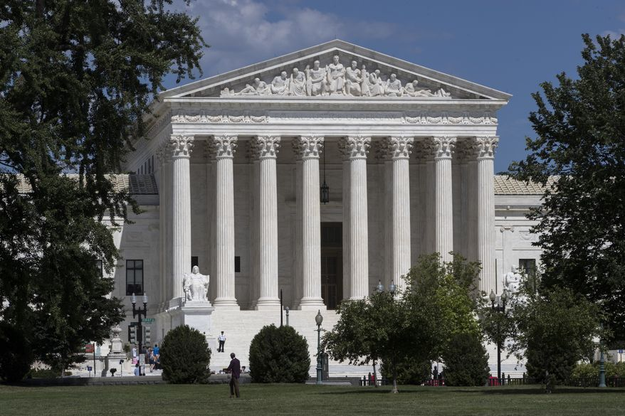 In this June 26, 2017, file photo, the Supreme Court is seen in Washington. (AP Photo/J. Scott Applewhite) ** FILE **