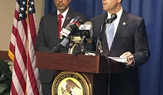 U.S. Attorney Jay Town, right, discusses the indictment of two prominent lawyers and a coal executive during a news conference in Birmingham, Ala., on Thursday, Sept. 28, 2017. Town said the three men are accused of conspiring to bribe a former state legislator who previously pleaded guilty in a scheme to lessen the impact of an environmental cleanup. At left is Angel Castillo, the FBI's acting assistant special agent in charge.  (AP Photo/Jay Reeves)