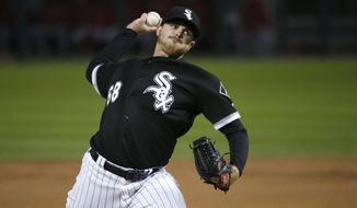 Chicago White Sox starting pitcher Dylan Covey delivers during the second inning of a baseball game against the Los Angeles Angels on Thursday, Sept. 28, 2017, in Chicago. (AP Photo/Charles Rex Arbogast)