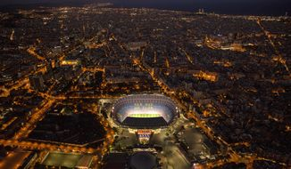 In this Tuesday, Sept. 19, 2017 photo, the Camp Nou stadium is illuminated in Barcelona, Spain. More than ever before, Barcelona will be more than just a club for Catalonia's separatists come Sunday. Barcelona's home match against Las Palmas falls on the day when secessionists have vowed to hold a referendum on independence from the rest of Spain. (AP Photo/Emilio Morenatti)