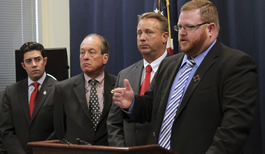 12th Judicial District Attorney John Suggs, right, and other members of the New Mexico District Attorneys' Association discuss proposed changes to the state's bail reform rules during a news conference in Albuquerque, N.M., on Thursday, Sept. 28, 2017. In response to a request for suggestions from the New Mexico Supreme Court, the association has submitted some proposed changes to the rules to address problems being experienced in judicial districts across the state. (AP Photo/Susan Montoya Bryan)