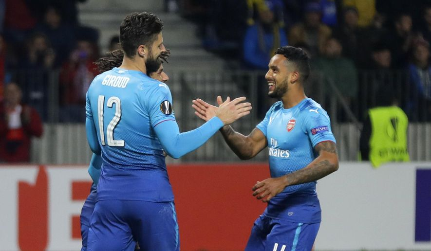 Arsenal's Olivier Giroud, left, celebrates with Theo Walcott after scoring his side's fourth goal during the Europa League group H soccer match between Bate and Arsenal at the Borisov-Arena stadium in Borisov, Belarus, Thursday, Sept. 28, 2017. (AP Photo/Sergei Grits)