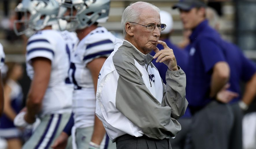 FILE - In this Sept. 16, 2017, file photo, Kansas State coach Bill Snyder watches as players warm up for an NCAA college football game against Vanderbilt in Nashville, Tenn. For the first time in the Big 12, Kansas State will play all of its conference games in consecutive weeks. (AP Photo/Mark Zaleski, File)