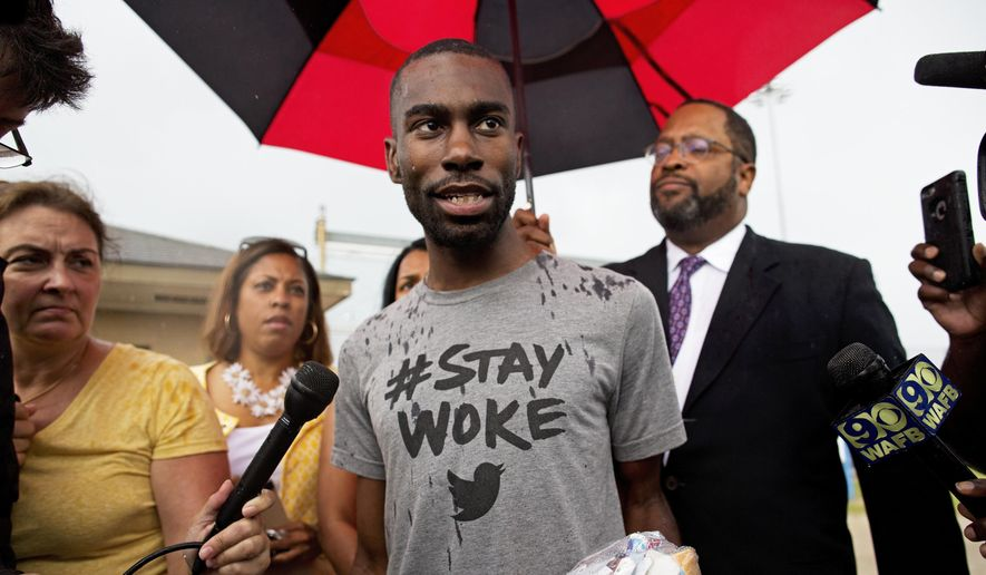 In this file photo, Black Lives Matter activist DeRay Mckesson talks to the media after his release from the Baton Rouge jail in Baton Rouge, Louisiana, July 10, 2016. (AP Photo/Max Becherer) ** FILE **