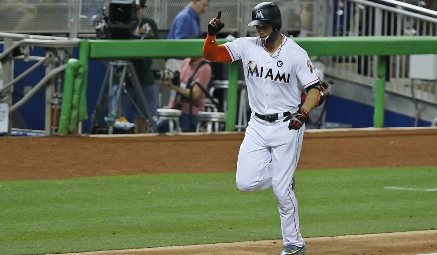 Miami Marlins' Giancarlo Stanton celebrates as heads for home plate after hitting a home run during the fourth inning of a baseball game against the Atlanta Braves, Thursday, Sept. 28, 2017, in Miami. (AP Photo/Wilfredo Lee)