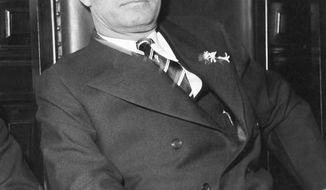 FILE- This file photo from 1933 shows Georgia Gov. Eugene Talmadge in Atlanta. A populist Democrat who stoked fierce loyalty among rural whites in the 1930s and '40s, Gov. Talmadge unflinchingly defended segregation in Georgia. Now city officials in Savannah plan to vote on a resolution urging state lawmakers to remove Talmadge's name from the towering suspension bridge that spans the Savannah River. (AP Photo)