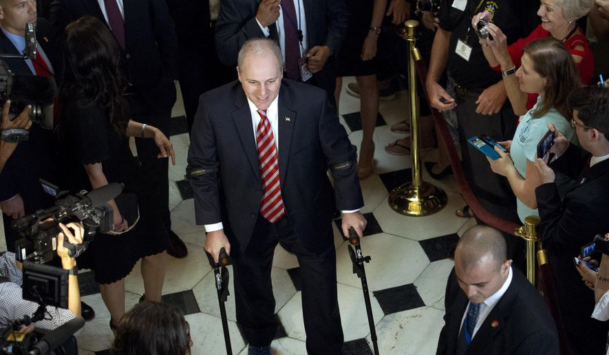 House Republican Whip Steve Scalise leaves the House chamber in the Capitol in Washington, Thursday, Sept. 28, 2017. To hugs and a roaring bipartisan standing ovation, Scalise returned to the House, more than three months after a baseball practice shooting left him fighting for his life.( AP Photo/Jose Luis Magana)