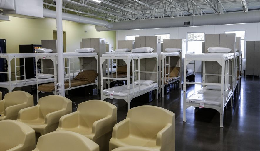Beds are seen next to the television lounge area in a new facility at the Community Corrections Center in Lincoln, Neb., Thursday, Sept. 28, 2017. Nebraska's prison system has completed the new 100-bed housing unit for work-release inmates ahead of schedule and under it's projected budget. Corrections Director Scott Frakes says he's confident his department will meet a state-mandated deadline to reduce prison crowding by 2020. (AP Photo/Nati Harnik)