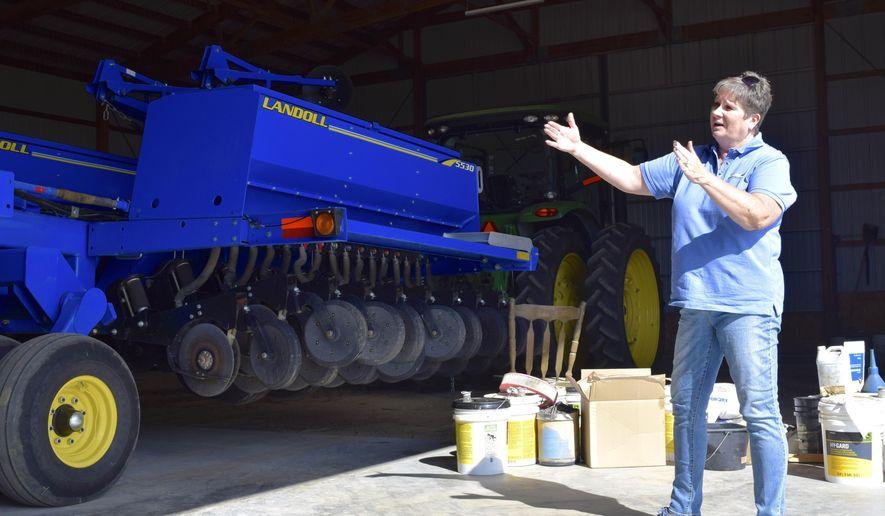 In this Wednesday, Sept. 13, 2017, photo, Colleen Peppler, co-owner of Peppler Farms in Platteville, Colo, gives a tour of her family's farm in Platteville, Colo. (Katarina Velazquez/The Greeley Tribune via AP)
