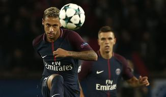 PSG's Neymar watches the ball during the Champions League Group B soccer match between Paris Saint-Germain and Bayern Munich in Paris, France, Wednesday, Sept. 27, 2017. (AP Photo/Thibault Camus)