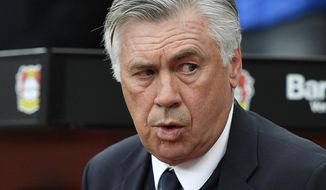 FILE - In this April 15, 2017 fiel photo Bayern head coach Carlo Ancelotti arrives to the German Bundesliga soccer match between Bayer Leverkusen and Bayern Munich in Leverkusen, Germany. (AP Photo/Martin Meissner, file)