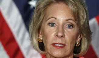 FILE - In this Sept. 7, 2017, file photo, Education Secretary Betsy DeVos speaks at George Mason University Arlington, Va., campus. DeVos is scheduled to speak on Thursday, Sept. 28, at Harvard University. (AP Photo/Jacquelyn Martin, File)