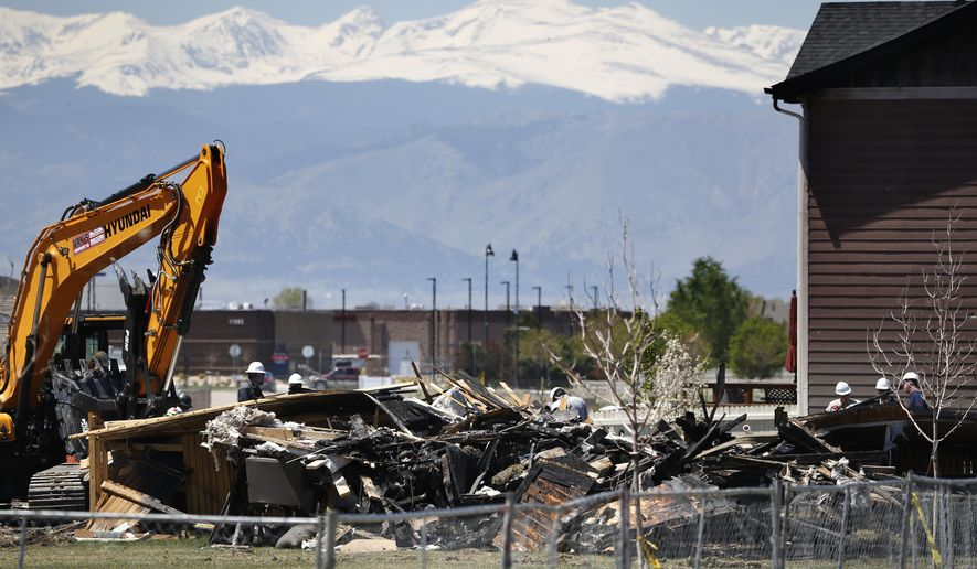 FILE - In this May 4, 2017, file photo, workers dismantle the charred remains of a house destroyed by an explosion triggered by natural gas in Firestone, Colo. Colorado regulators said that nearly 430 oil or gas pipelines near occupied buildings in Colorado failed a pressure test that the state ordered after the explosion. (AP Photo/Brennan Linsley, File)