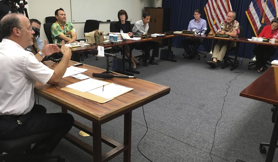 Consultant Joe Hinish, left, tells the Honolulu Police Commission on Thursday, Sept. 28, 2017 about assessments semifinalists vying to be the department's next chief underwent. The commission voted to send seven finalists to the next round in selecting a replacement for Louis Kealoha, who resigned amid a federal corruption investigation. (AP Photo/Jennifer Sinco Kelleher)