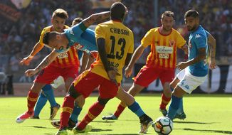 "FILE - In this Sept. 17, 2017 file photo, Napoli's Marek Hamsik vies for the ball with Benevento's Raman Chibsah, center, during a Serie A match soccer match between Napoli and Benevento, at the San Paolo stadium in Naples, Italy. Benevento is giving new meaning to the term ""cellar dweller."" Six matches into its Serie A debut season, the southern Italian club is being labeled the worst squad in Europe's five major leagues.  (Cesare Abbate/ANSA via AP, files)"