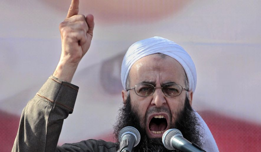 FILE - In this March 4, 2011 file photo, Sheikh Ahmad al-Assir, a Lebanese anti-Syrian regime leader, addresses his supporters during a demonstration against Syrian President Bashar Assad, at Martyrs Square in downtown of Beirut, Lebanon. On Thursday, Sept 28, 2017, a military judge is scheduled to issue a verdict in the case against Sheikh Ahmad al-Assir and 33 others on charges of fighting the Lebanese army in the southern city of Sidon in 2013. (AP Photo/Hussein Malla, File)