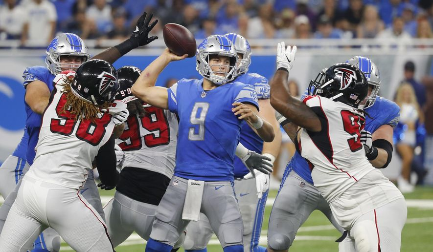 FILE - In this Sunday, Sept. 24, 2017, file photo, Detroit Lions quarterback Matthew Stafford (9) throws under pressure from the Atlanta Falcons during an NFL football game in Detroit. The Detroit Lions and their fourth-quarter success came up inches and seconds short last week. The Minnesota Vikings remember well the feeling of a crushing loss, thanks to the Lions in an overtime game in Minnesota last fall.  (AP Photo/Paul Sancya, File)