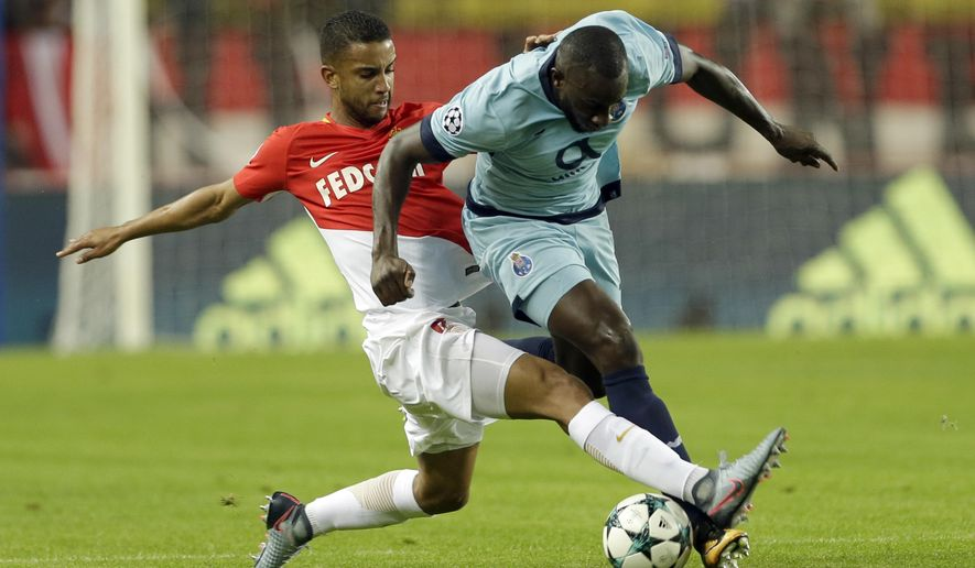 Monaco's Jorge, left, and Porto's Moussa Marega challenges for the ball during their Champions League Group G first leg soccer match between Monaco and FC Porto at Louis II stadium in Monaco, Tuesday, Sept. 26, 2017. (AP Photo/Claude Paris) =