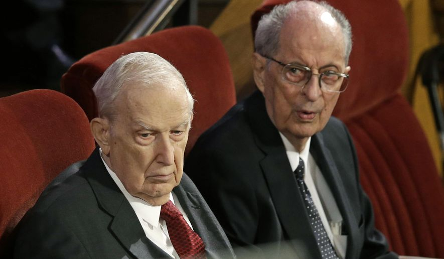 FILE - This July 10, 2015, file photo, shows Richard G. Scott, left, and Robert D. Hales, right, attending the memorial service for Mormon leader Boyd K. Packer at the Tabernacle on Temple Square in Salt Lake City.    Church spokesman Eric Hawkins said Thursday, Sept. 28, 2017,  Hales was taken to hospital several days ago for treatment of pulmonary and other conditions. The 85-year-old Hales won't attend the religion's twice-yearly conference on advice of his doctors. (AP Photo/Rick Bowmer, File)