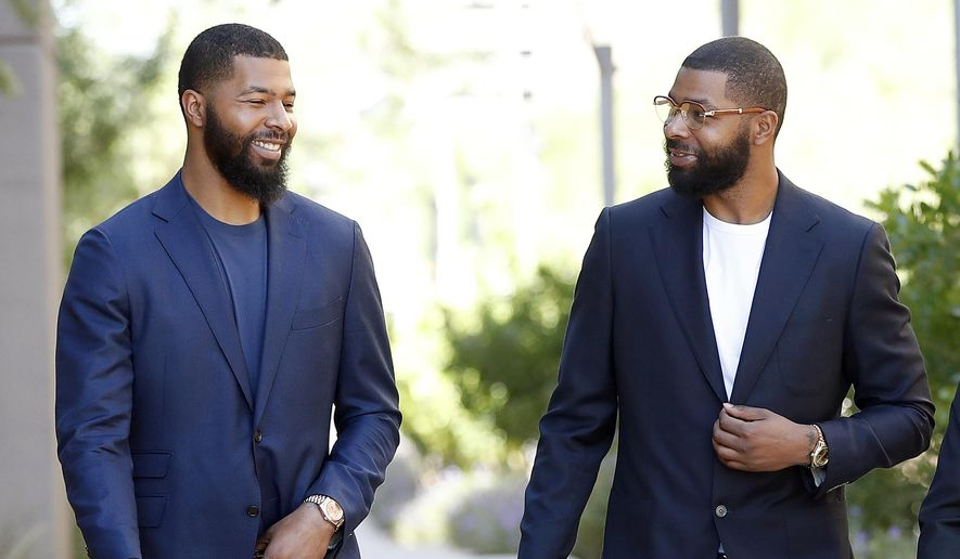 FILE in this Sept. 19, 2017 file photo, NBA players Markieff, left, and Marcus Morris arrive at Superior Court for the second day of their aggravated assault trial in Phoenix.  Jurors are expected to hear closing arguments Thursday, Sept. 28,  for the assault trial of the NBA players.  The Morris brothers are accused of helping three other people beat Erik Hood on Jan. 24, 2015. (AP Photo/Matt York, File) **FILE**
