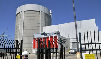 FILE - This June 24, 2010, file photo shows the Palisades nuclear power plant in Covert Township, Mich. New Orleans-based Entergy Corp announced Thursday, Sept. 28, 2017, it is delaying the closure of the Palisades nuclear power plant in southwestern Michigan by four years until spring of 2022. (John Madill /The Herald-Palladium via AP, File)