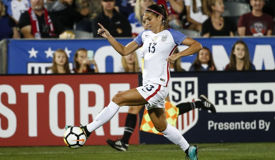 In this Sept. 15, 2017 photo, U.S. forward Alex Morgan (13) moves the ball against New Zealand during the first half of an international friendly soccer match in Commerce City, Colo. The U.S. Women's National Team Players Association is donating $16,000 to help get the union for players in the National Women's Soccer League off the ground. The NWSL Players Association represents more than 160 players who are not paid by the U.S. and Canadian soccer federations. Those federations pay the salaries of several national team players who are allocated across the five-year-old women's professional league.(AP Photo/Jack Dempsey)
