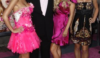 "FILE - In this Aug. 20, 2008 file photo, Holly Madison, from left, Hugh Hefner, Bridget Marquardt, and Kendra Wilkinson arrive at the premiere of ""The House Bunny"" in Los Angeles. Playboy founder Hefner, the pipe-smoking hedonist who revved up the sexual revolution in the 1950s and built a multimedia empire of clubs, mansions, movies and television, symbolized by bow-tied women in bunny costumes, has died at age 91. Hefner died of natural causes at his home surrounded by family Wednesday night, Sept. 27, 2017, Playboy said in a statement. (AP Photo/Matt Sayles, File)"
