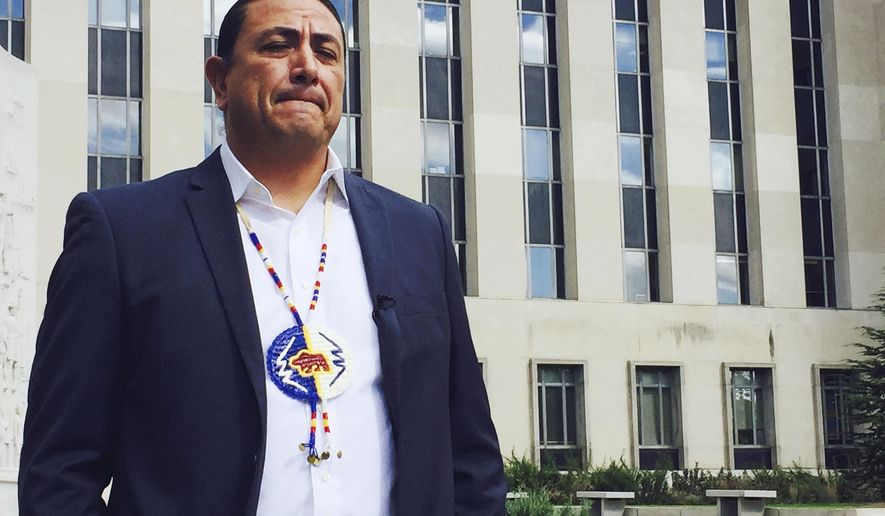 FILE - In this Oct. 5, 2016, file photo, Dave Archambault, chairman of the Standing Rock Sioux Tribe, stands outside a federal appeals court in Washington where judges heard his tribe's challenge to the Dakota Access pipeline. Archambault, the American Indian leader who spearheaded opposition to the four-state Dakota Access pipeline has been ousted as Standing Rock Sioux chairman. Archambault conceded defeat in a statement Thursday, Sept. 28, 2017. (AP Photo/Jessica Gresko, File)