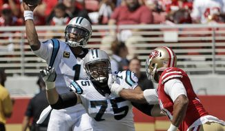 FILE - In this Sept. 10, 2017, file photo, Carolina Panthers quarterback Cam Newton (1) throws a pass as offensive tackle Matt Kalil (75) blocks during the first half of an NFL football game against the San Francisco 49ers in Santa Clara, Calif. The Panthers spent $55 million on Kalil to protect Newton's blindside. But this season has been a struggle so far for Kalil, who has given up a rash of sacks to start the season. (AP Photo/Marcio Jose Sanchez, File)