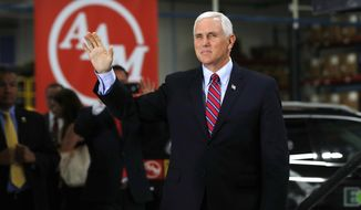 Vice President Mike Pence arrives to speak at American Axle & Manufacturing in Auburn Hills, Mich., Sept. 18, 2017. (AP Photo/Paul Sancya)