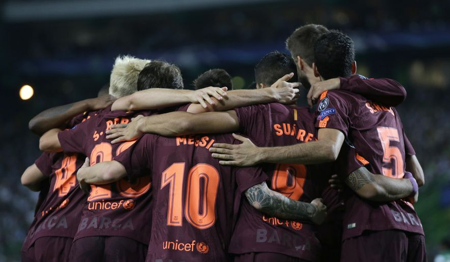 Barcelona's Lionel Messi, number 10, celebrates with team mates after an own goal by Sporting's Sebastian Coates during a Champions League, Group D soccer match between Sporting CP and FC Barcelona at the Alvalade stadium in Lisbon, Wednesday Sept. 27, 2017. (AP Photo/Armando Franca)