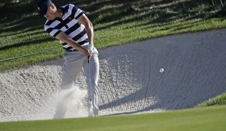 Jordan Spieth hits from a sand trap on the 11th hole during the Presidents Cup foursomes golf matches at Liberty National Golf Club in Jersey City, N.J., Thursday, Sept. 28, 2017. (AP Photo/Julio Cortez)