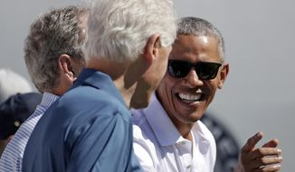 Former President Barack Obama, right, jokes with formers Presidents Bill Clinton, center and George Bush, left, before the first round of the Presidents Cup at Liberty National Golf Club in Jersey City, N.J., Thursday, Sept. 28, 2017. (AP Photo/Julio Cortez)