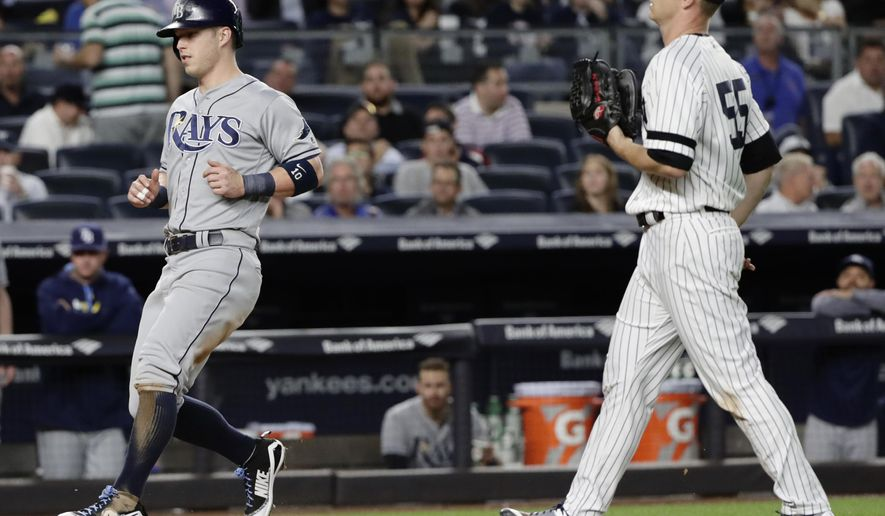 Tampa Bay Rays' Corey Dickerson (10) runs past New York Yankees starting pitcher Sonny Gray (55) to score on a passed ball during the fifth inning of a baseball game Thursday, Sept. 28, 2017, in New York. (AP Photo/Frank Franklin II)
