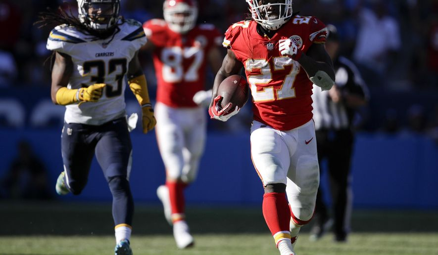 FILE - In this Sept. 24, 2017, file photo, Kansas City Chiefs running back Kareem Hunt, right, runs for a touchdown against the Los Angeles Chargers during the second half of an NFL football game in Carson, Calif. Hunt was the AFC offensive player of the month after he led the league with 401 yards rushing, caught nine passes for 137 yards and reached the end zone five times. The Chiefs face the Washington Redskins this week. (AP Photo/Jae C. Hong, File)