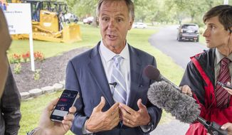 In this Sept. 5, 2017, photo, Tennessee Gov. Bill Haslam speaks to reporters in Brentwood, Tenn. The Republican told reporters on Thursday, Sept. 28 that he is considering entering the race to succeed Republican Bob Corker in the U.S. Senate. (AP Photo/Erik Schelzig)