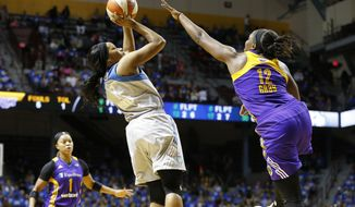 Minnesota Lynx's Jia Perkins, center, shoots as Los Angeles Sparks' Chelsea Gray defends during the first half of Game 2 in the WNBA basketball finals Tuesday, Sept. 26, 2017, in Minneapolis. (AP Photo/Jim Mone)