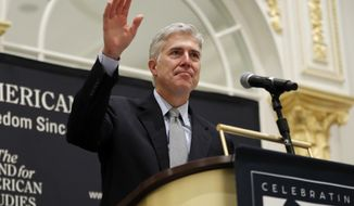 Supreme Court Justice Neil Gorsuch acknowledges the applauses as he beings to speak at the 50th anniversary of the Fund for America Studies luncheon at the Trump Hotel in Washington, Thursday, Sept. 28, 2017. (AP Photo/Pablo Martinez Monsivais)
