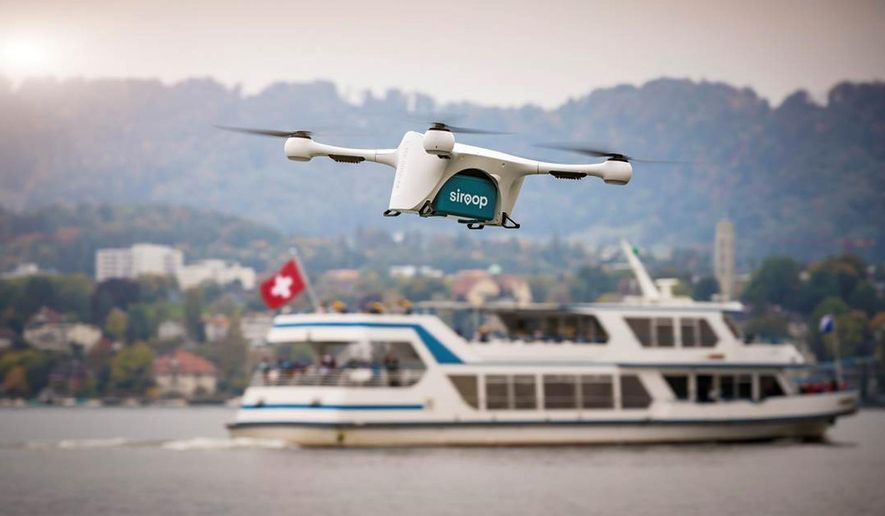 In this image made available from Matternet Thursday Sept. 28, 2017, a Matternet drone is pictured transporting on-demand e-commerce goods in Zurich, Switzerland.  Drones will soon start to deliver small items in Zurich as part of a pilot project, the first of its kind over a populated area, transporting goods about 8 to 16 kilometers (5 to 10 miles) to awaiting delivery vans and the van drivers will then deliver them to customers. (Matternet via AP)