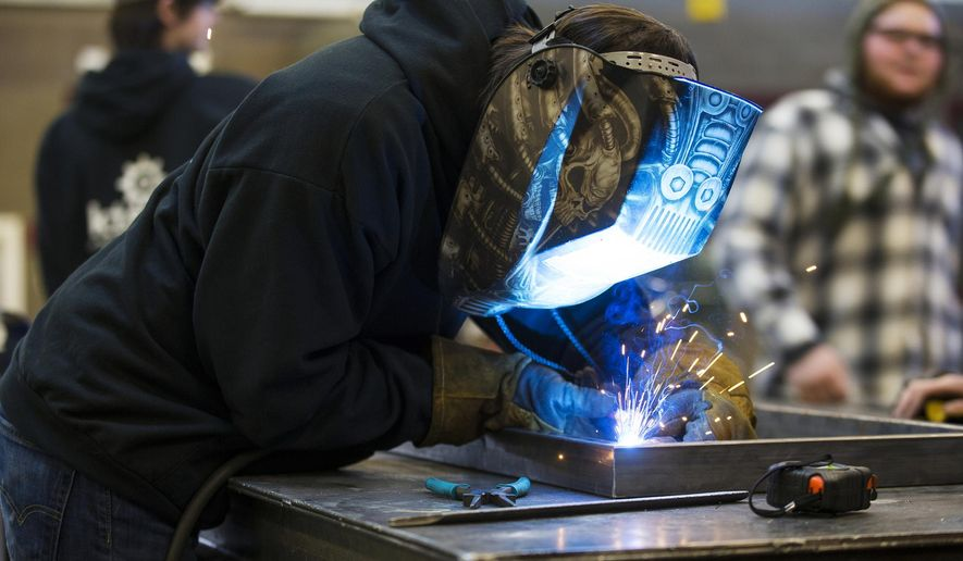 In a December 2016 photo, Kootenai Technical Education student Trevor Karras welds a Borah Elementary School Buddy Bench. KTEC is available to Coeur d'Alene, Post Falls and Lakeland school district 11th- and 12th-grade students and offers programs like automotive technology, welding, automated manufacturing, design and many more. (Loren Benoit /Coeur D'Alene Press via AP)