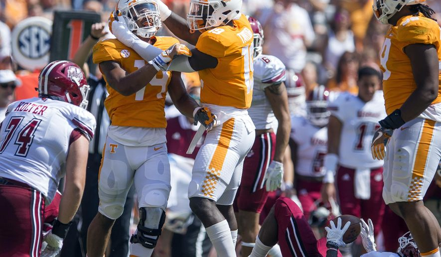 FILE - In this Saturday, Sept. 23, 2017, file photo, Tennessee linebacker Quart'e Sapp (14) and defensive lineman Darrell Taylor (19) celebrate after making a play against Massachusetts during an NCAA college football game in Knoxville, Tenn. Tennessee is coming off a seven-sack performance against Massachusetts as the Volunteers prepare to face No. 7 Georgia and freshman quarterback Jake Fromm. (Clavin Mattheis/Knoxville News Sentinel via AP)