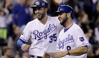 Kansas City Royals' Eric Hosmer (35) and Mike Moustakas (8) celebrate after they scored on a double by Alcides Escobar during the eighth inning of a baseball game against the Detroit Tigers on Wednesday, Sept. 27, 2017, in Kansas City, Mo. (AP Photo/Charlie Riedel)