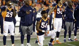 FILE - In this Monday, Oct. 24, 2016, file photo, Denver Broncos inside linebacker Brandon Marshall (54) takes a knee during the national anthem prior to an NFL football game against the Houston Texans, in Denver. Marshall said the NFL can show its support of its players by hiring quarterback Colin Kaepernick. He's the one who started the national anthem protests last year to bring attention to racial inequality. (AP Photo/Jack Dempsey, File)
