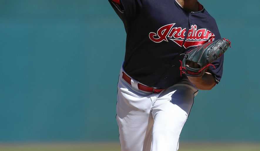 Cleveland Indians starting pitcher Carlos Carrasco delivers against the Minnesota Twins during the first inning in a baseball game, Thursday, Sept. 28, 2017, in Cleveland. (AP Photo/Ron Schwane)